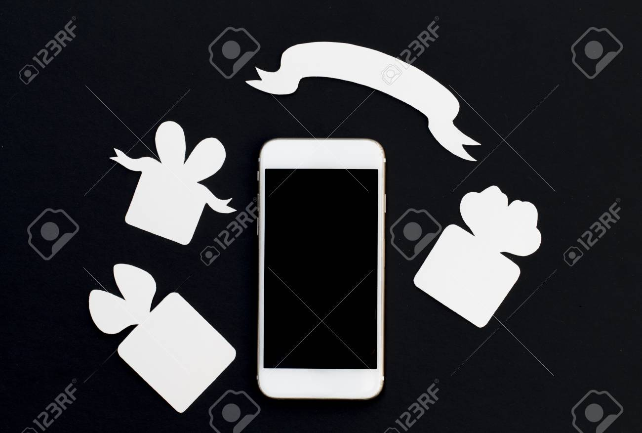 white phone with gift boxes and blank ribbon banner on black stock