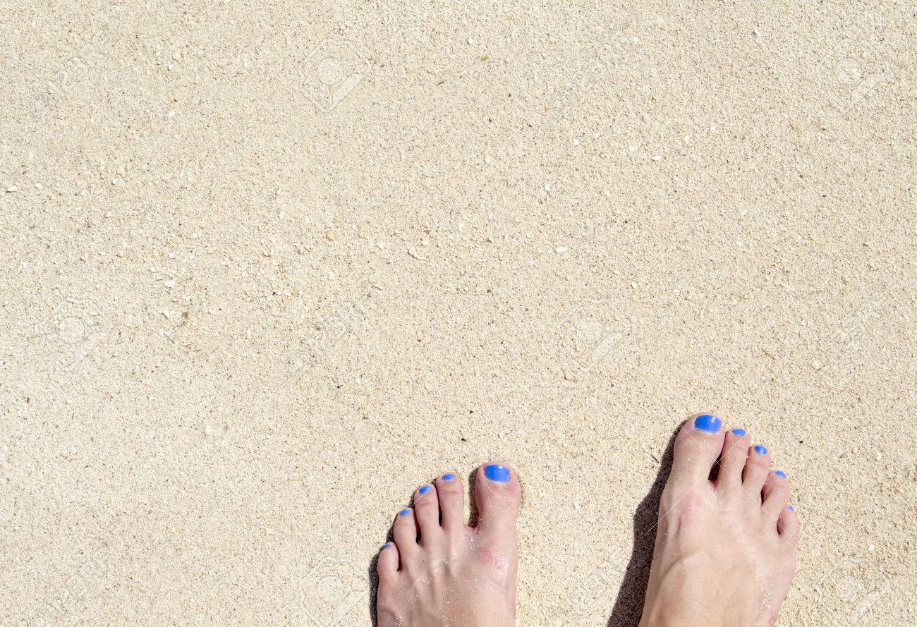Woman Feet On White Beach Sand Top View Photo For Background Sunny