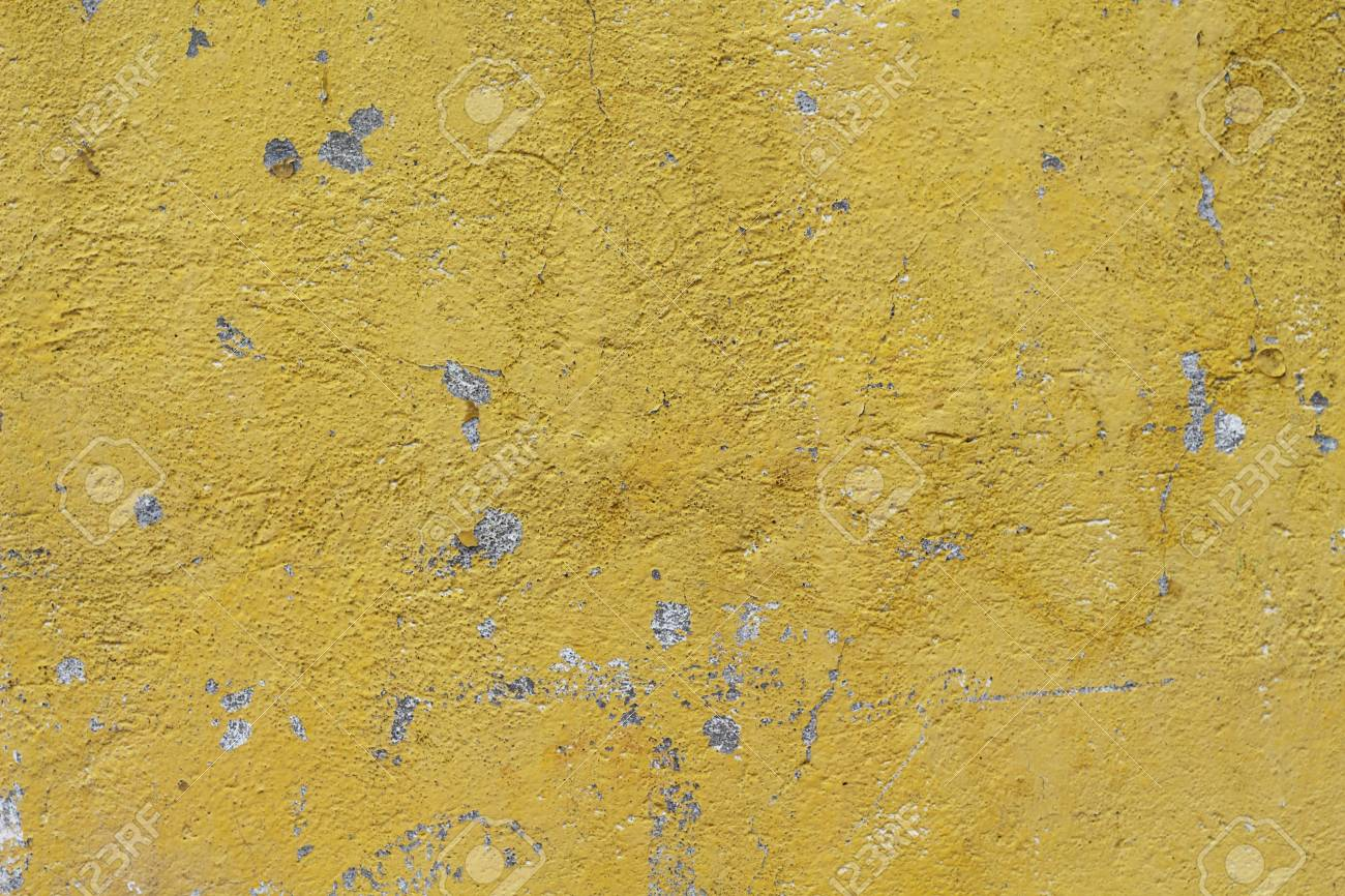 Weathered Yellow Painted Concrete Wall. Sunny Rough Plaster Photo ...