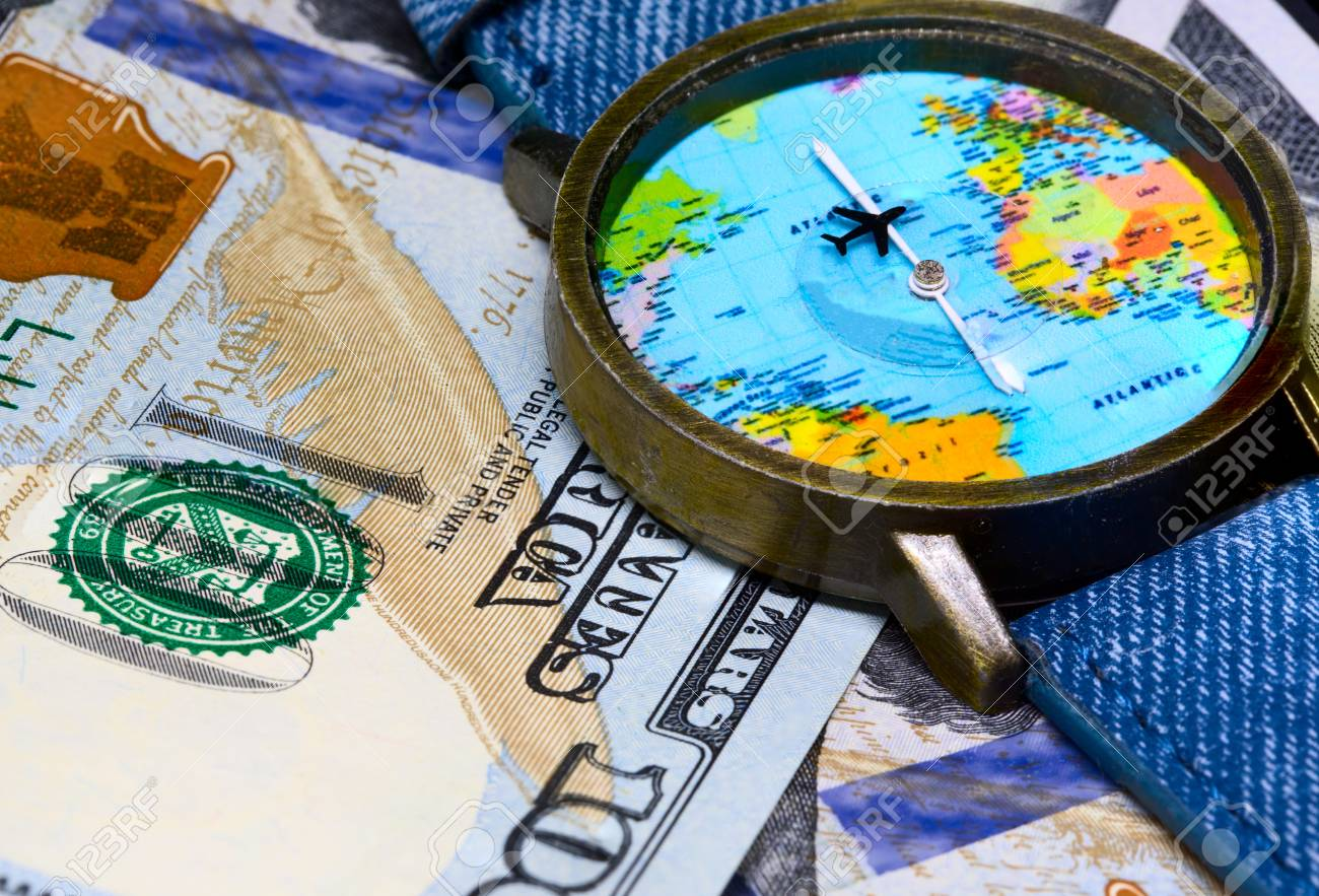 Watch with global map on cash money world map clock worldwide world map clock worldwide business concept cash banknotes background global business worldwide business travel emerging market profit gumiabroncs Image collections