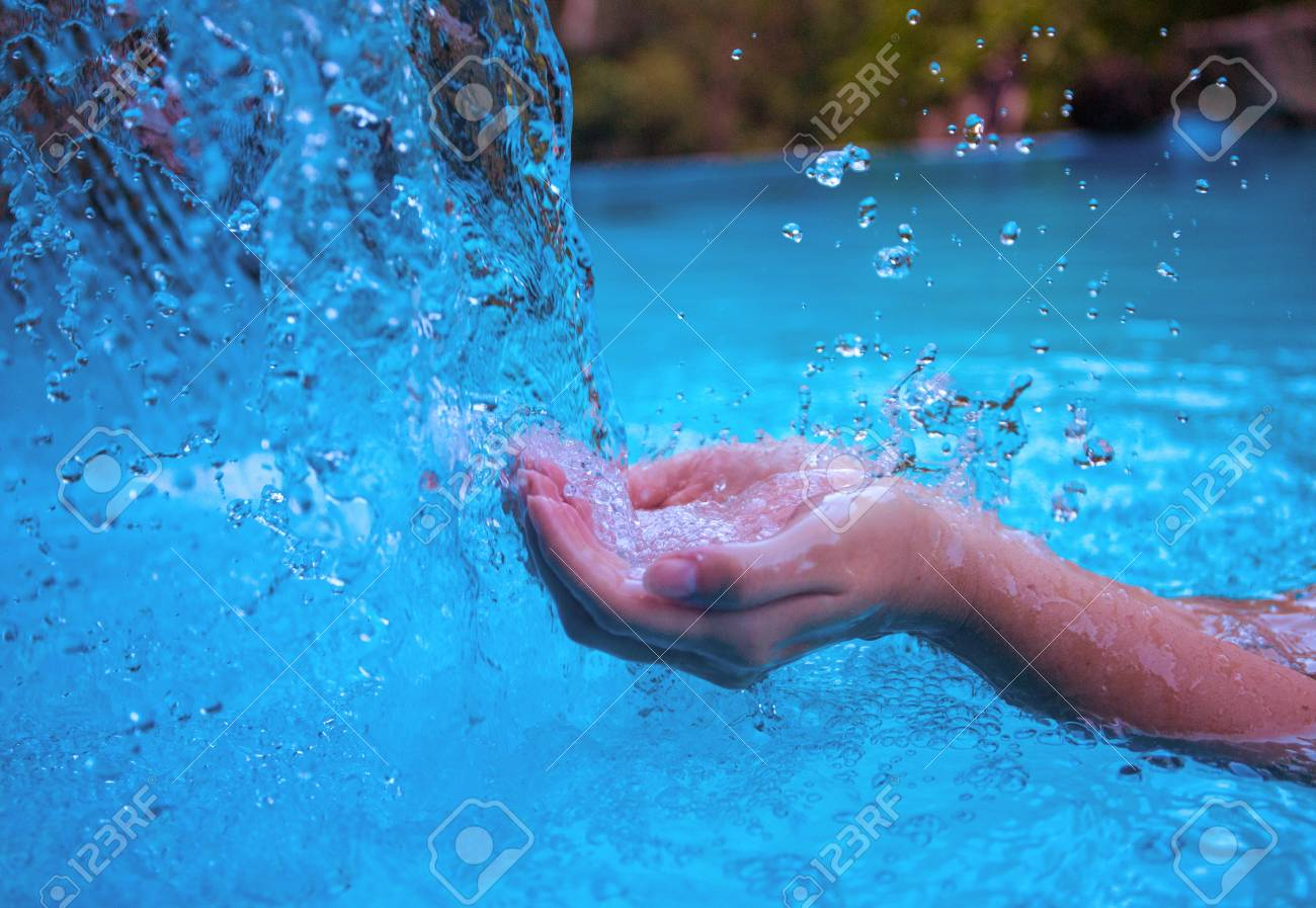Woman hands and blue water. Fresh clean water current. Girl\'s..