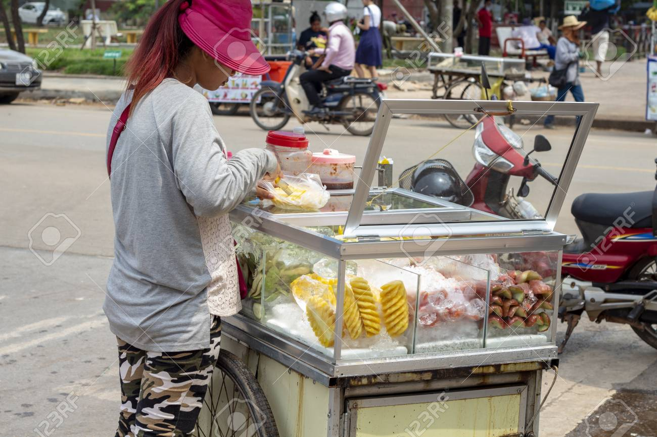 Siem Reap, Cambodia - 26 March, 2018: Young woman sell fruit