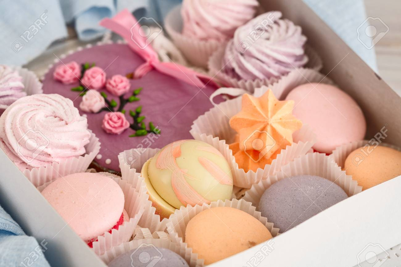 Pink Cakes For A Happy Womens Day White Wooden Table Gift Wrapping Stock Photo