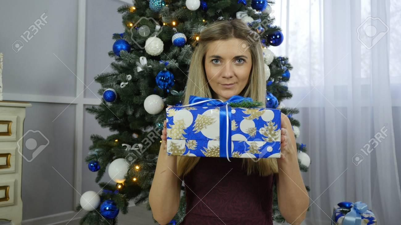 beautiful girl with Christmas gifts - 89981322