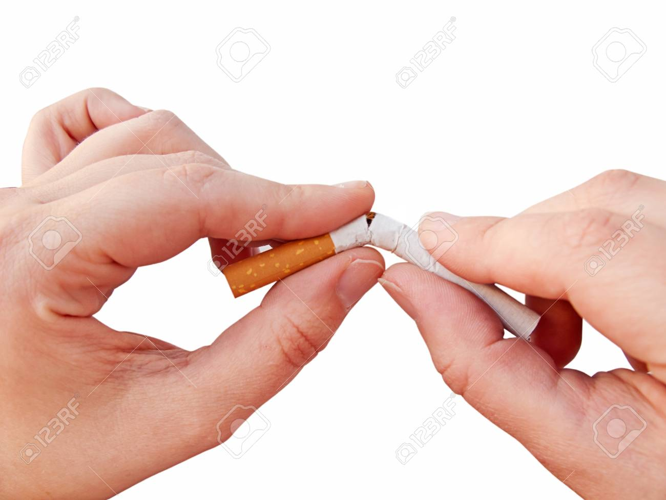 Hands breaking a cigarette, isolated in white Stock Photo - 11864251