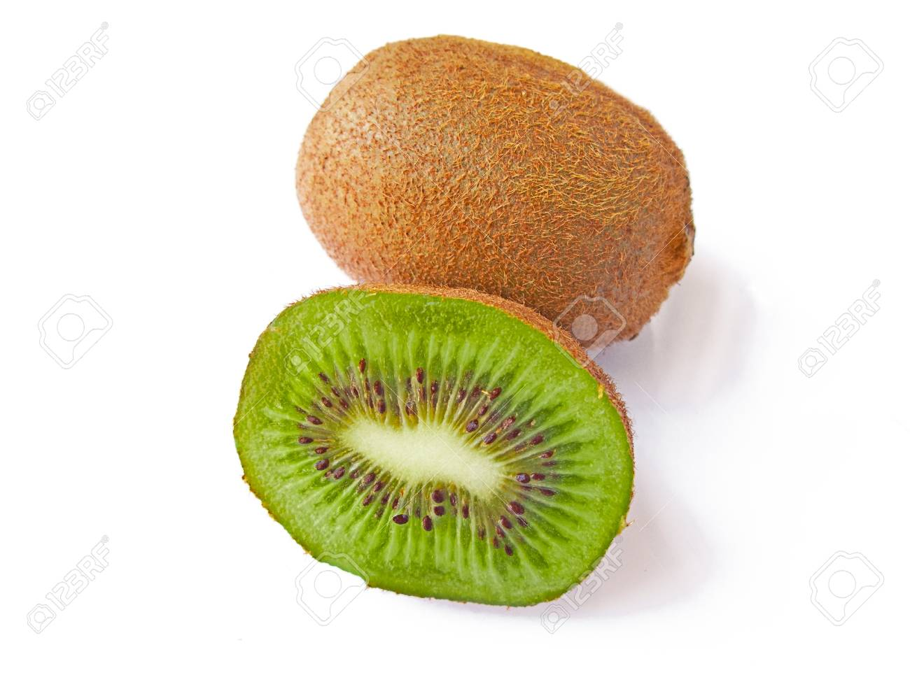 A kiwi and a half isolated in white Stock Photo - 11952856