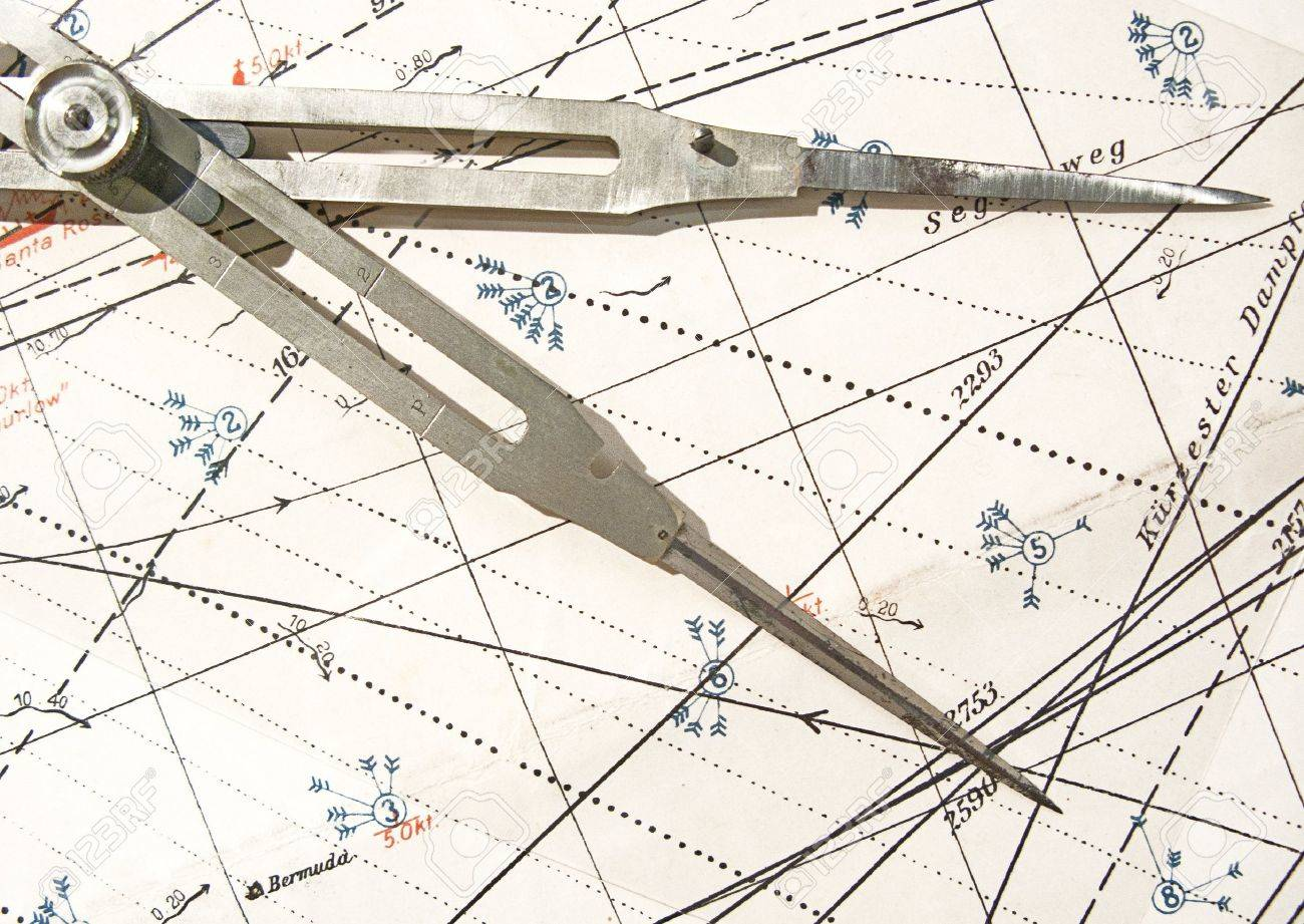 Old brass dividers on a nautical chart