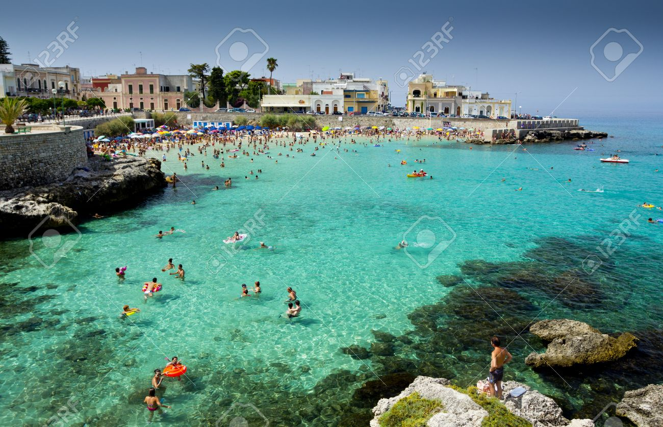Lecce, Italy - July 29, 2012 Vacationers Enjoying The Turquoise ...