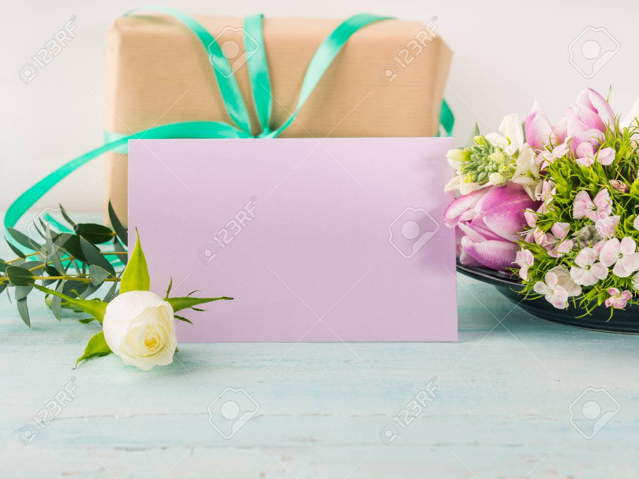 Empty purple card flowers tulips roses spring pastel color background. Easter holiday, wedding birthday invitation - 81457452