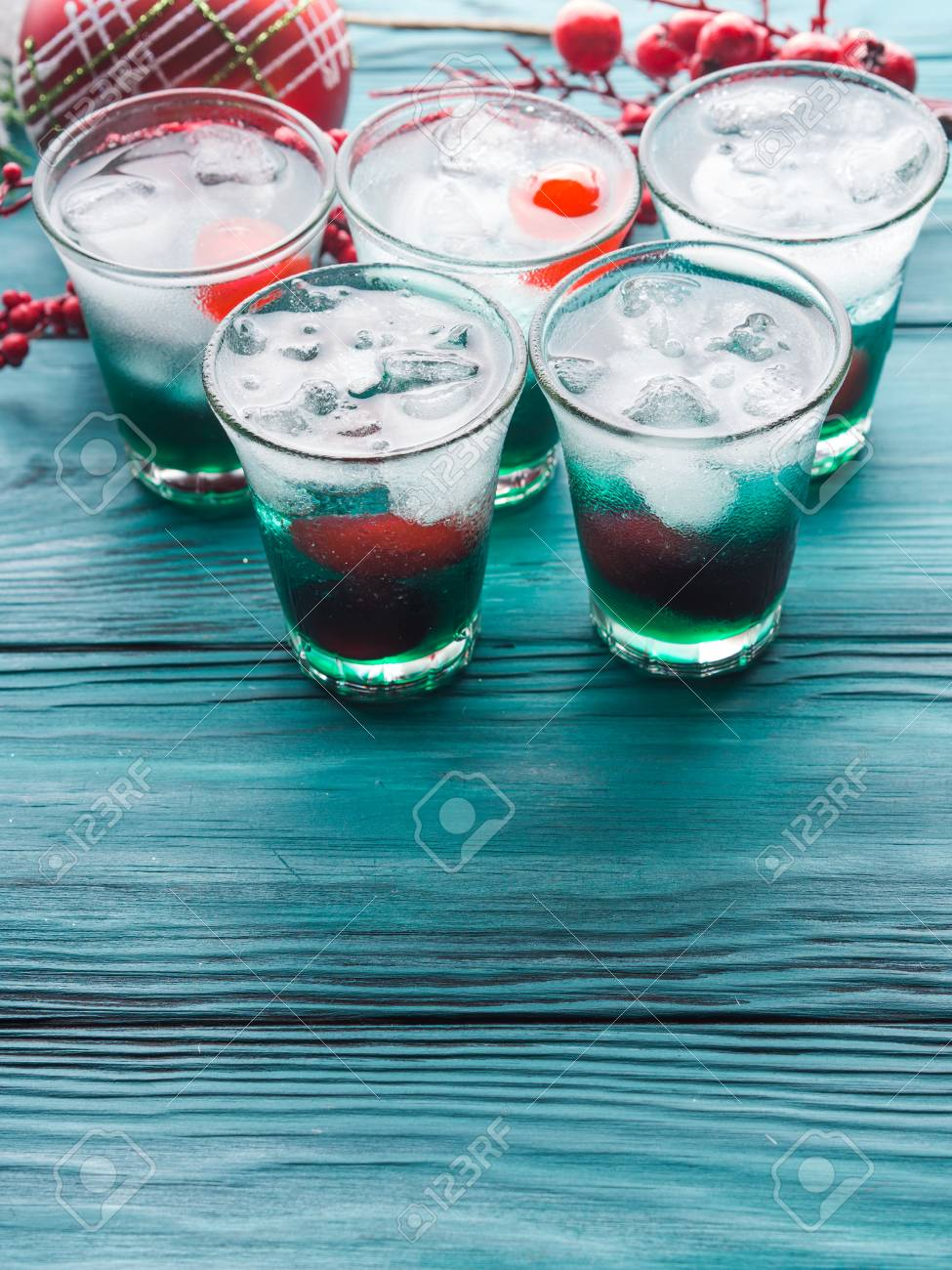 Christmas Alcoholic Drinks.Christmas Holiday Party Background With Green Alcohol Drinks