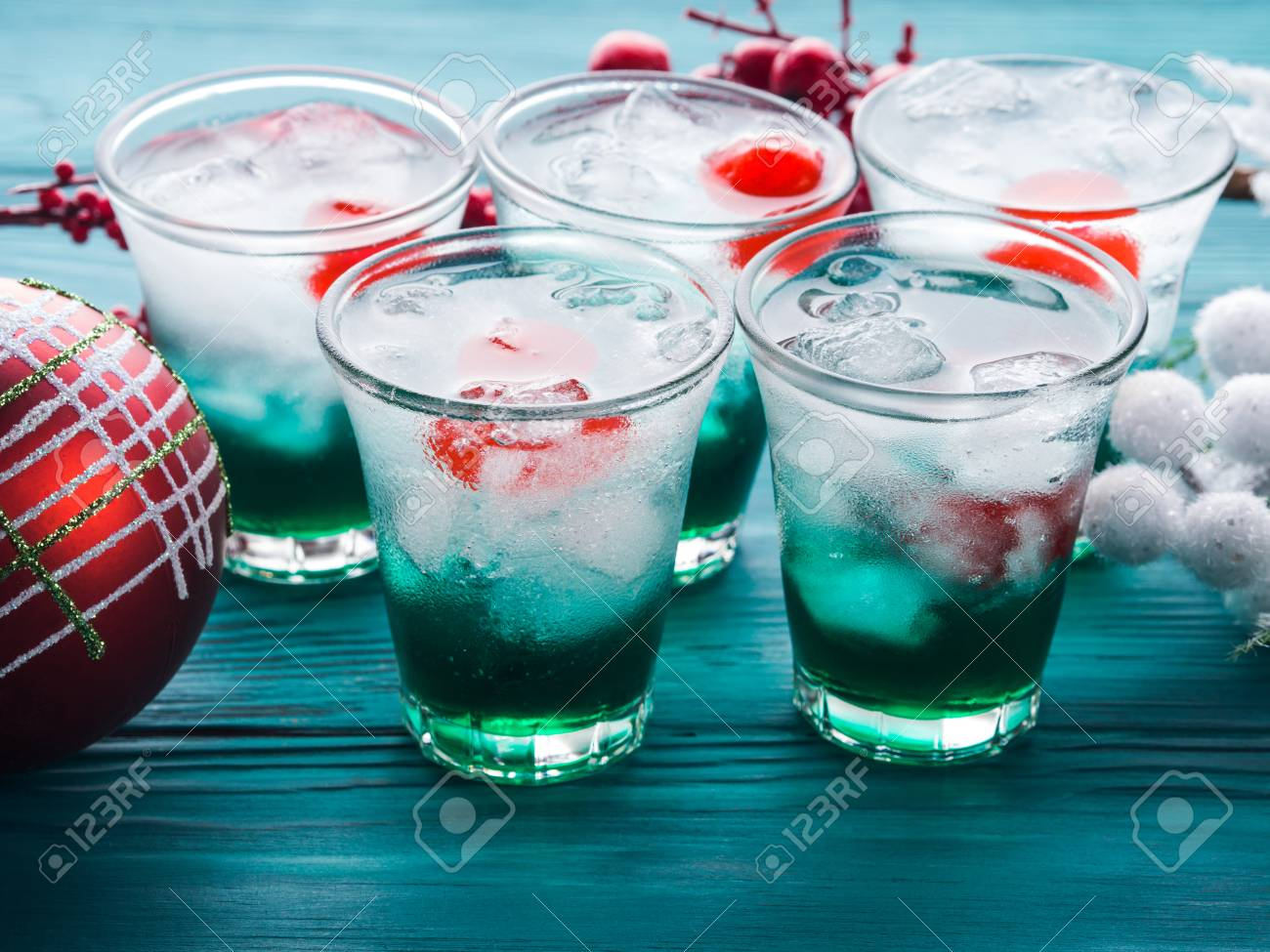 Christmas Alcoholic Drinks.Christmas Holiday Party Green Alcohol Drinks With Cherry Festive