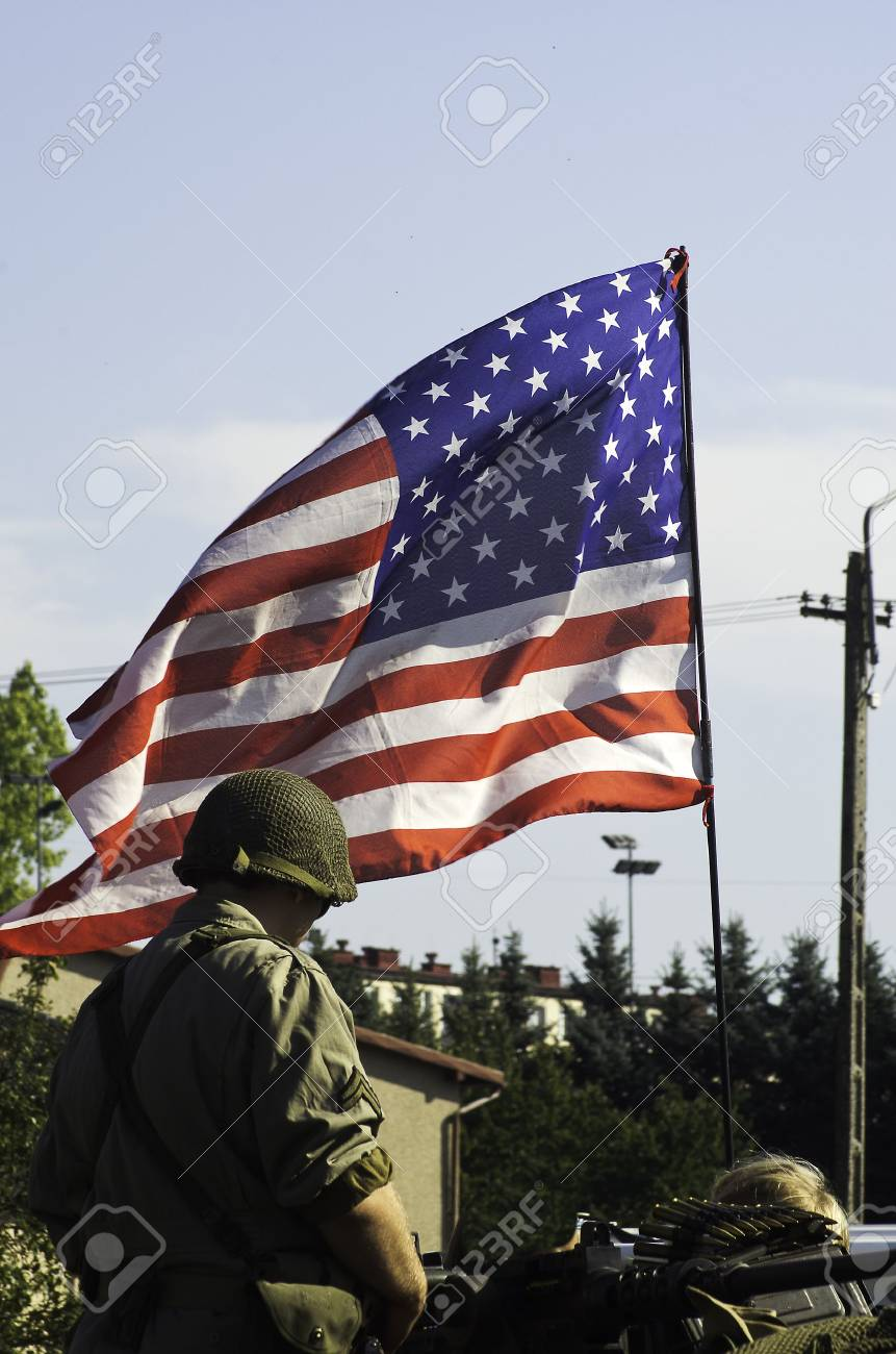 american soldier with the flag - 12200796
