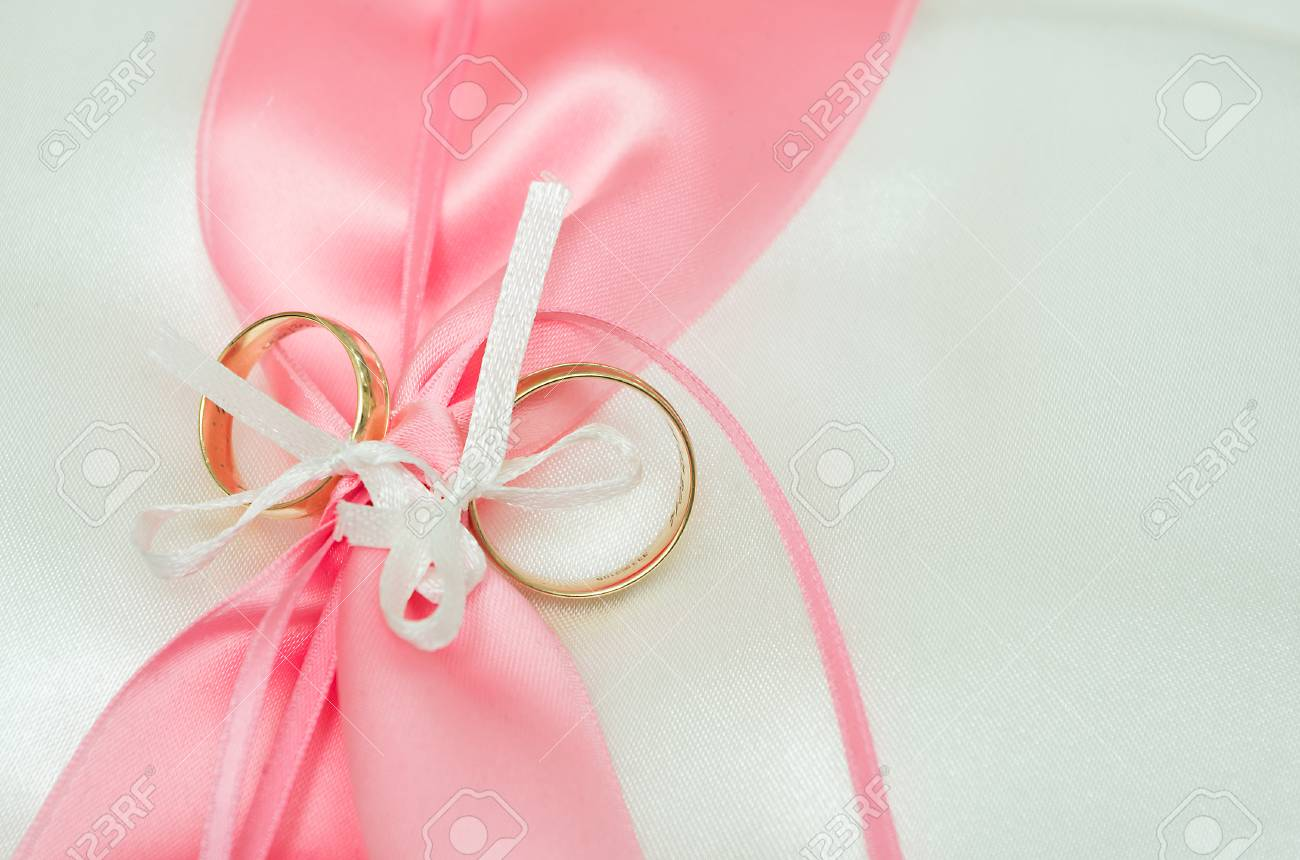 A Pair Of Wedding Rings, Decorated With Ribbons Stock Photo, Picture ...