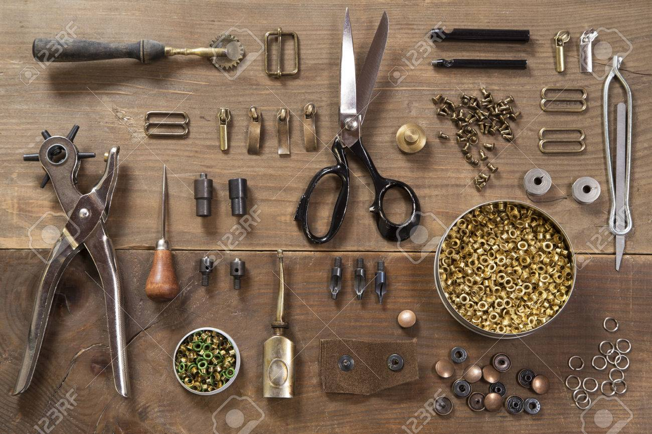 Leather craft tools on a wooden background - 38884541