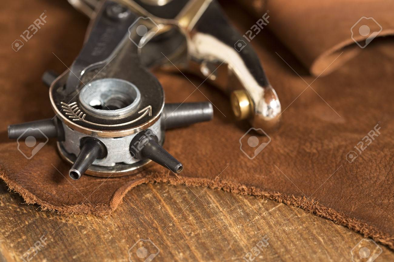 Leather craft punch on a piece of leather - 47251542