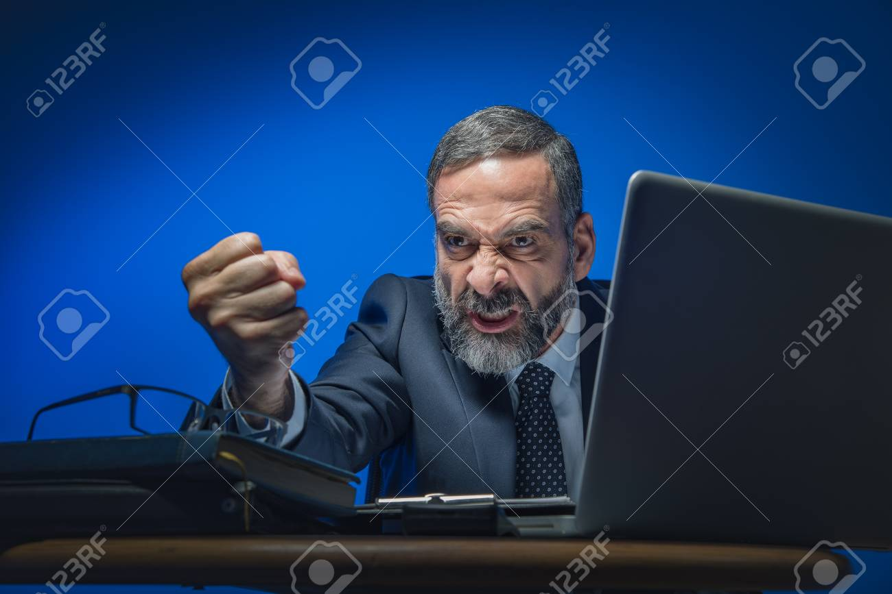 Image result for angry business man clenching his fist
