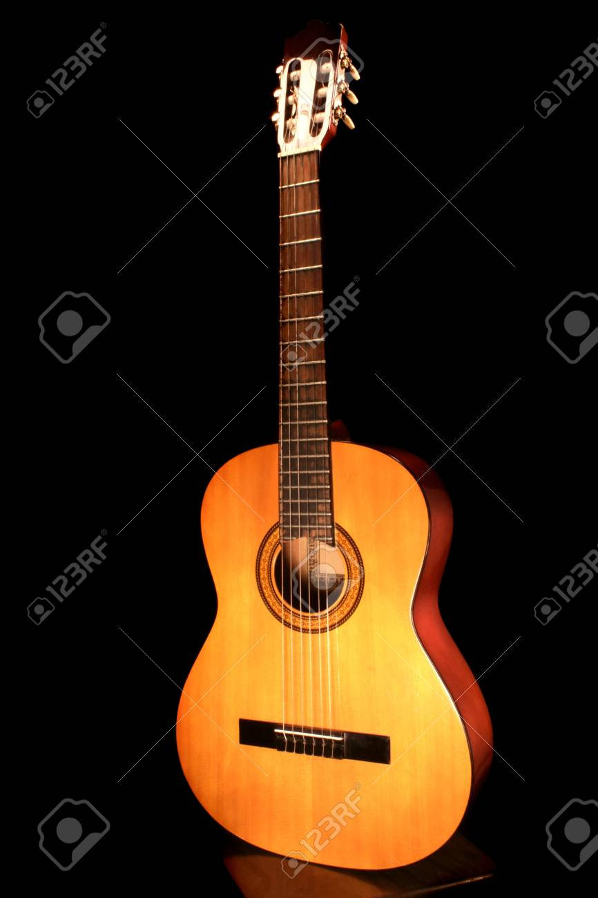 The Acoustic Guitar On The Black Background Stock Photo Picture And