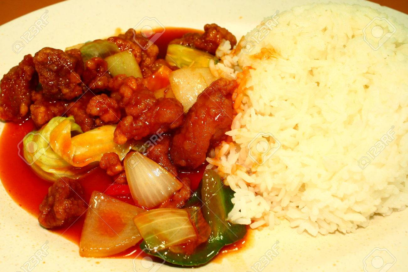 Chinese Dish Sweet Sour Pork And Rice Singapore Food Dinner Stock Photo