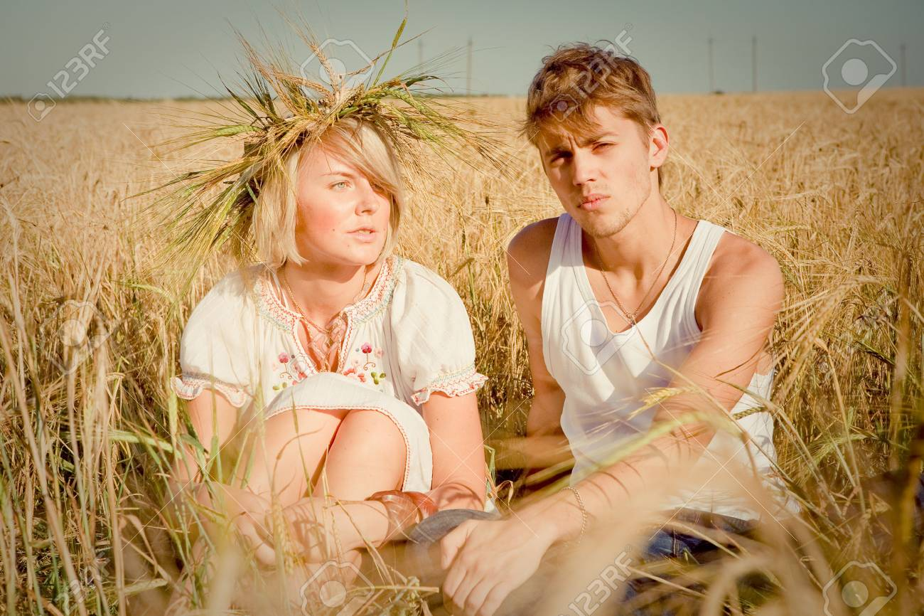 Image of happy young man and woman  on wheat field Stock Photo - 6128801