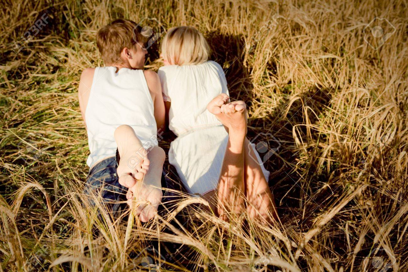 Image of young man and woman on wheat field - 8812998
