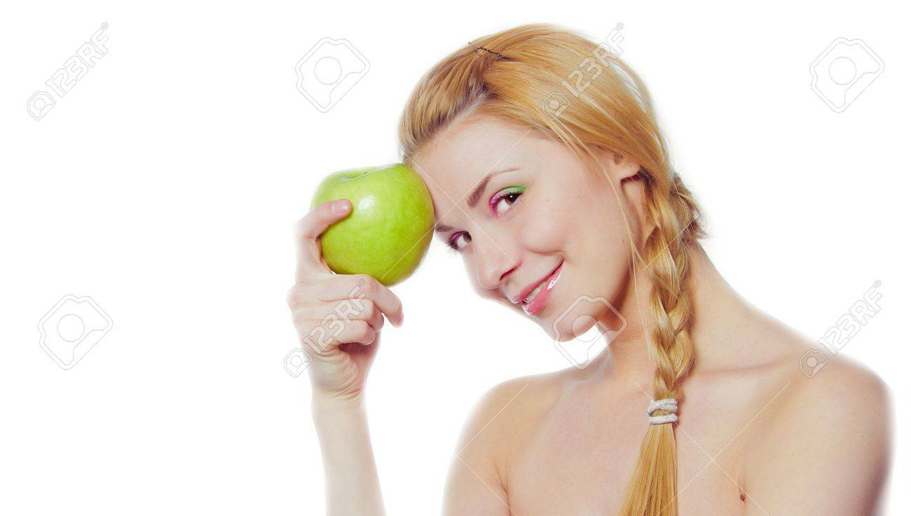 portrait of young woman with green apple isolated on white - 9405398