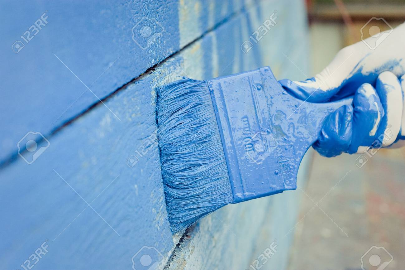 hand painting blue wooden wall - 18986912