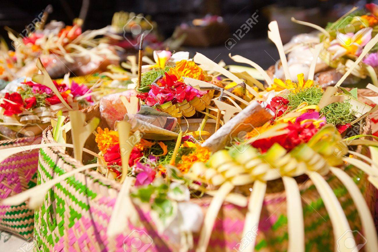 Offerings to gods in Bali with flowers, food and aroma sticks - 20225375