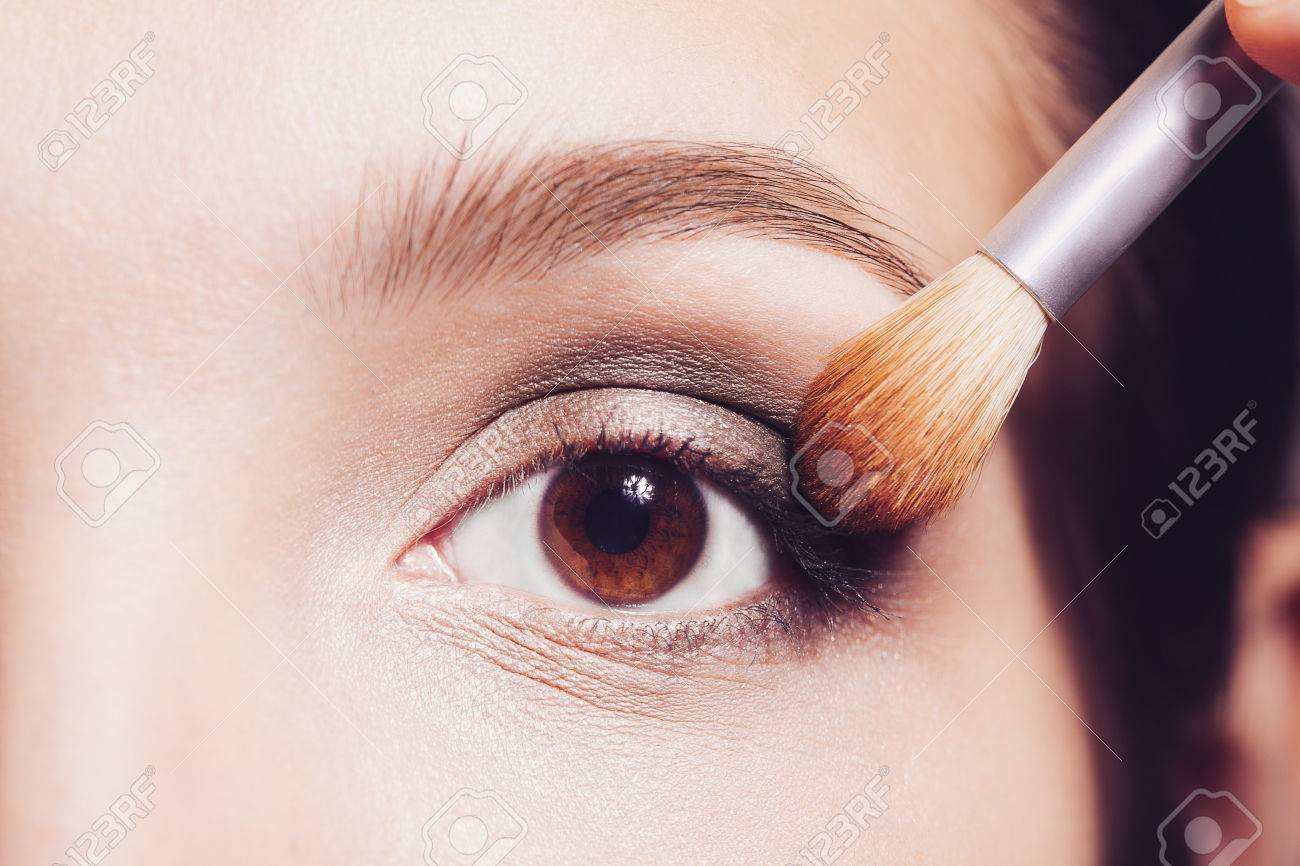 Eye makeup woman applying eyeshadow powder - 51764852