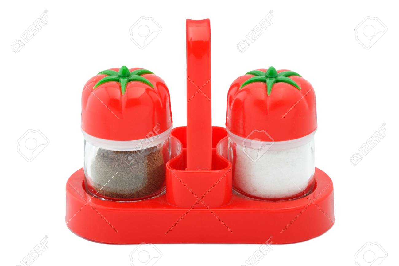 The complete set of a saltcellar and pepperbox in a red support Stock Photo - 3994461