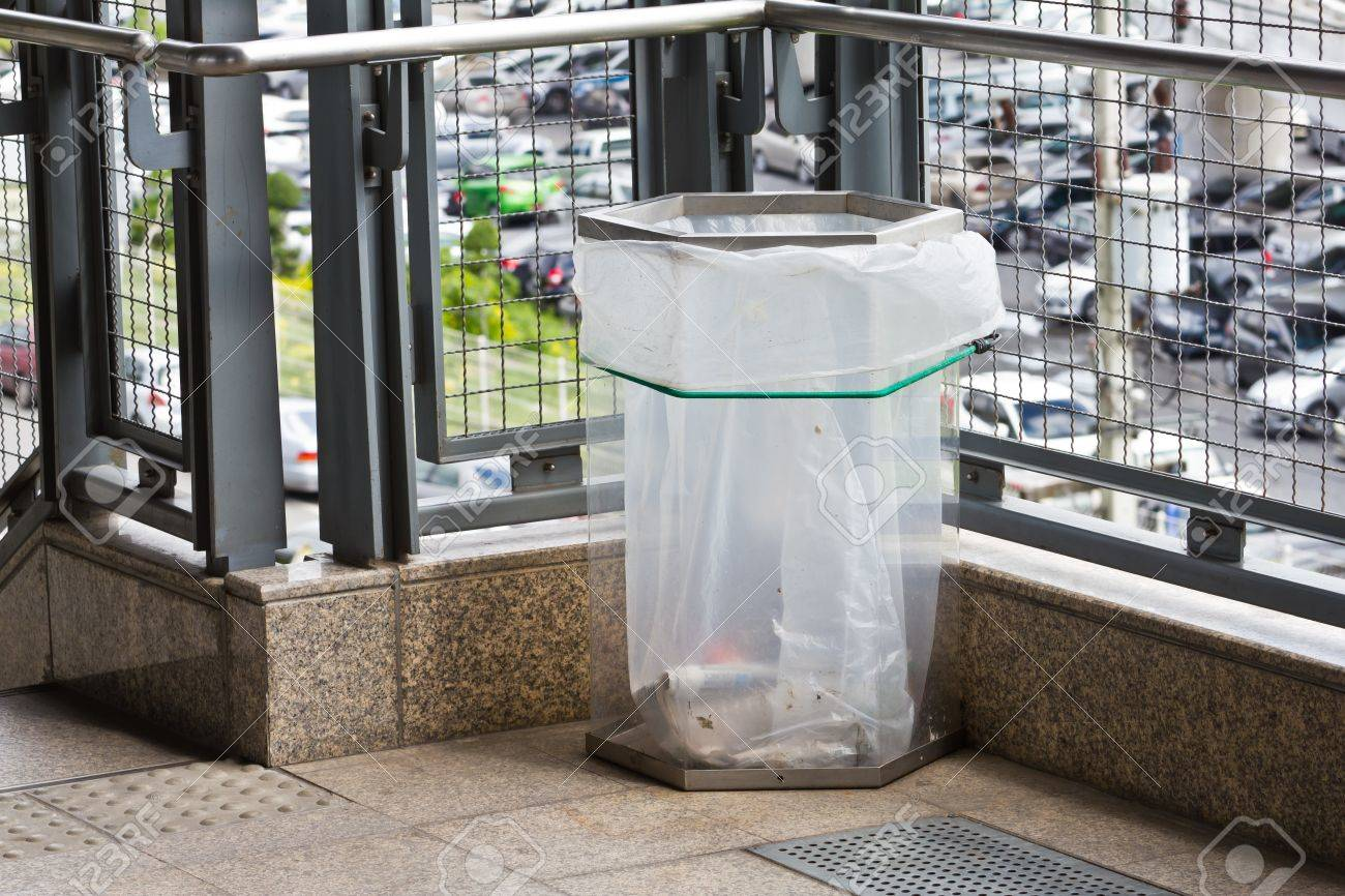 Trash can or garbage bin made of transparency plastic, used in city or crowded area for safety purpose - 14240693