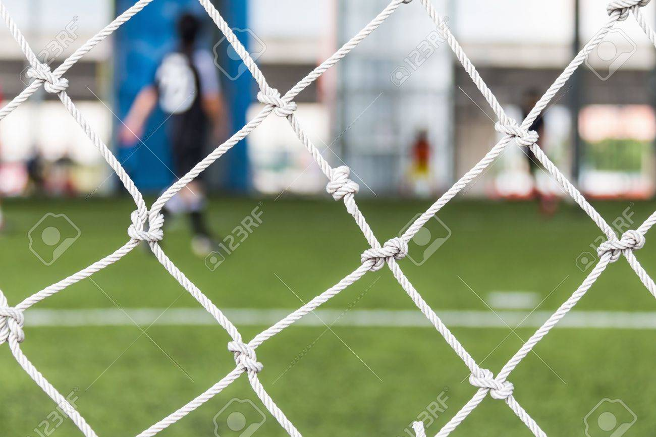 Close Up Of Football Or Soccer Goal Net In The Indoor Soccer Pitch Stock  Photo