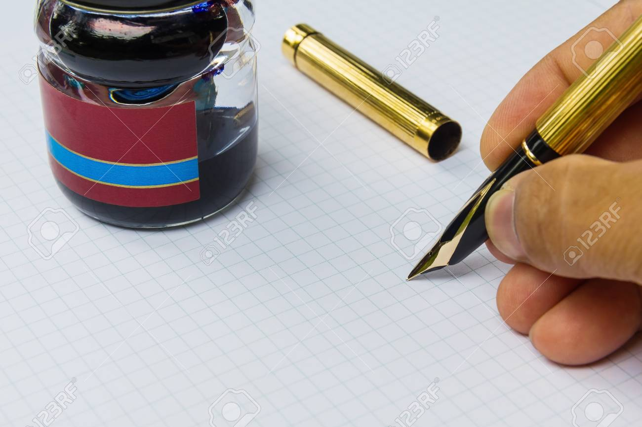 Writing with fountain on grid paper and refill ink bottle Stock Photo - 15446141