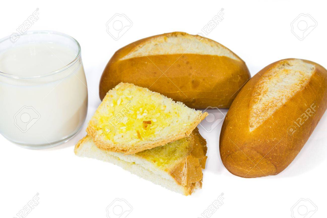 Two loaves of french baguette and a glass of milk and garlic bread, on white background Stock Photo - 18246481