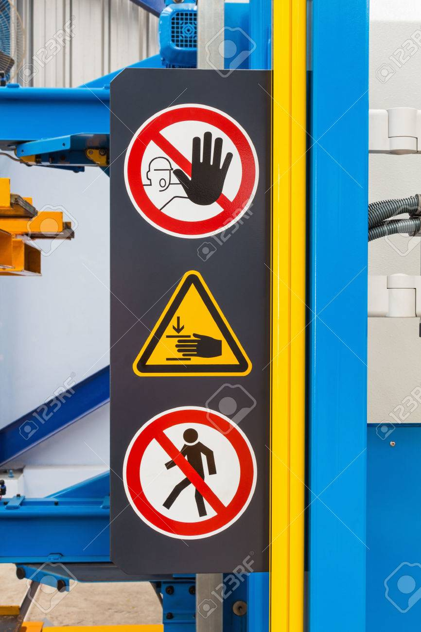 Warning sign for safety on machine, no entry and be careful of hand Stock Photo - 24257689
