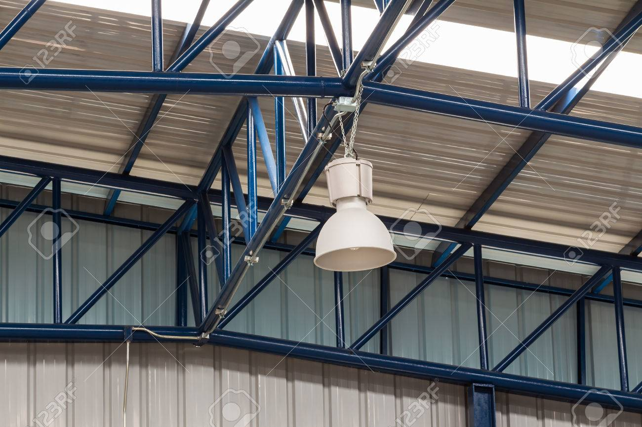 more photos 91240 3fb4d Close up of industrial overhead lighting fixture hanging on factory..