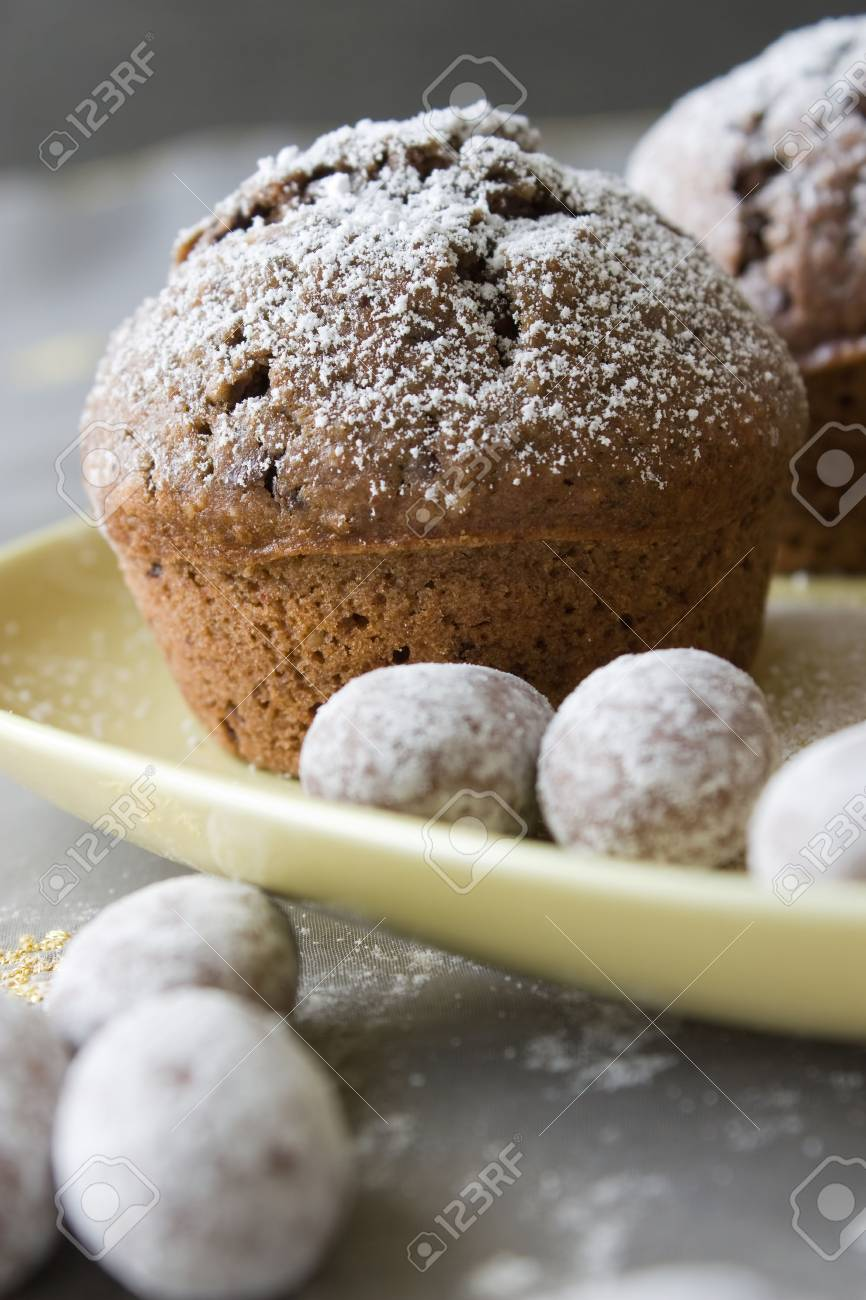 Closeup of Christmas decorated muffin with chocolate on a yellow plate Stock Photo - 5985322