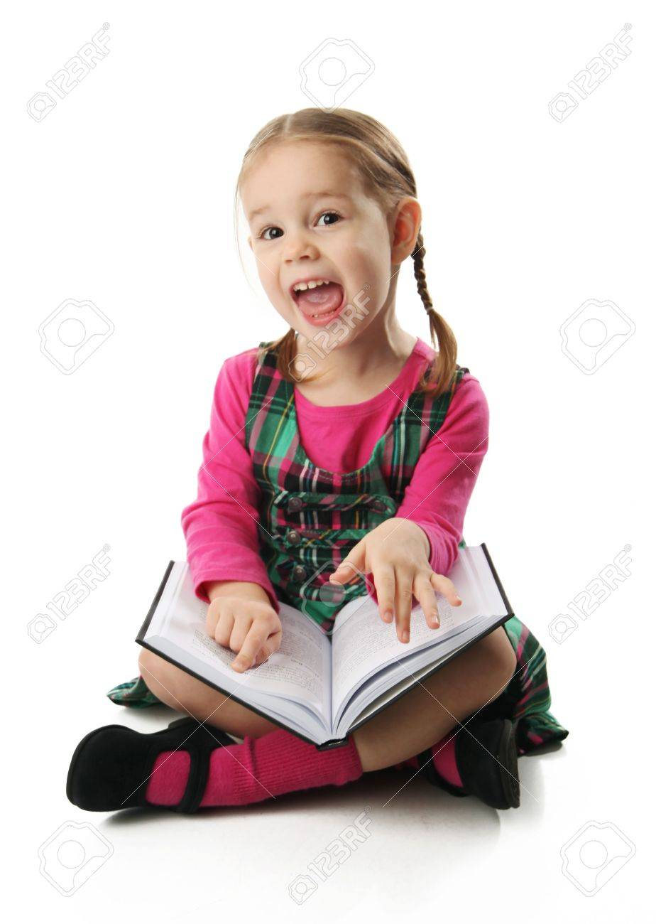 Cute Preschool Age Girl Sitting Down Reading A Book With A ...
