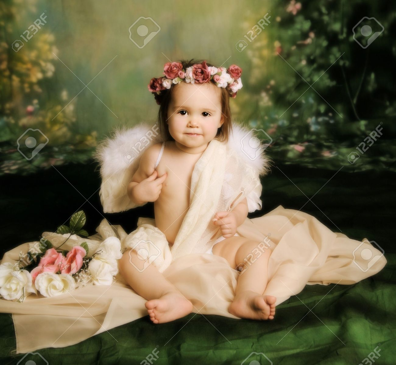 Elegant vintage style portrait of a baby girl dressed with angel wings and  a flower halo 1246358208a
