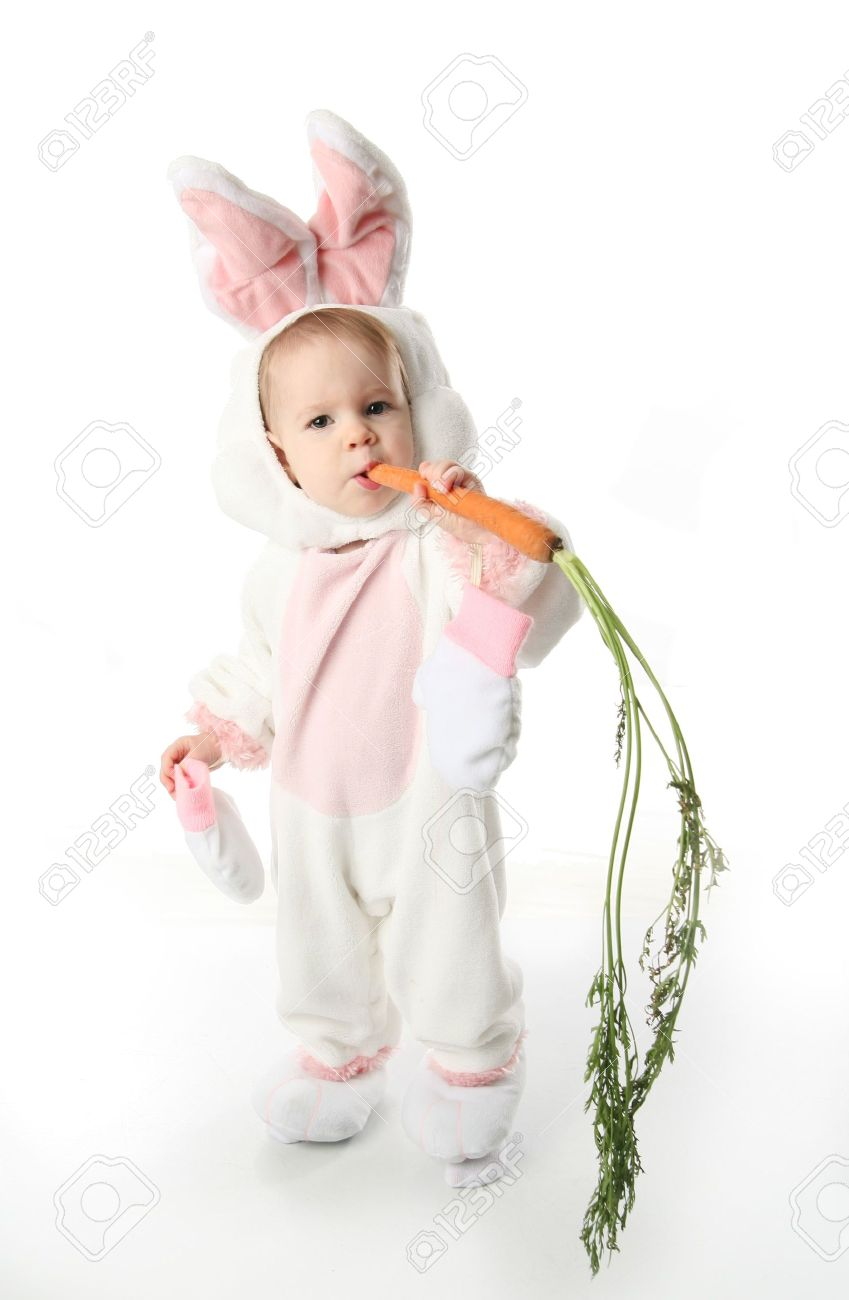Cute Young Toddler Girl Wearing A Bunny Rabbit Costume Chewing