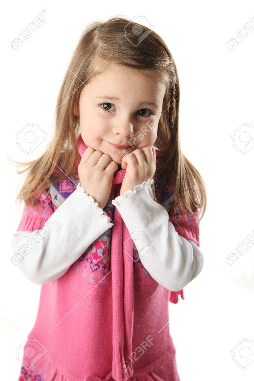 Portrait of a smilng adorable preschool girl wearing a knit pink dress and scarf - 8710212