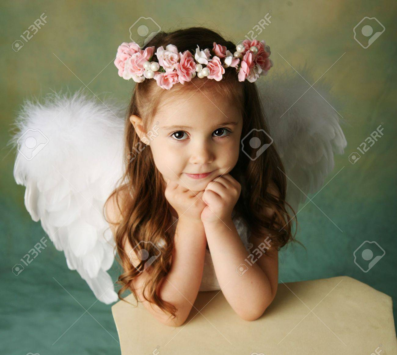 Beautiful Young Girl Wearing Angel Wings And Flower Halo With