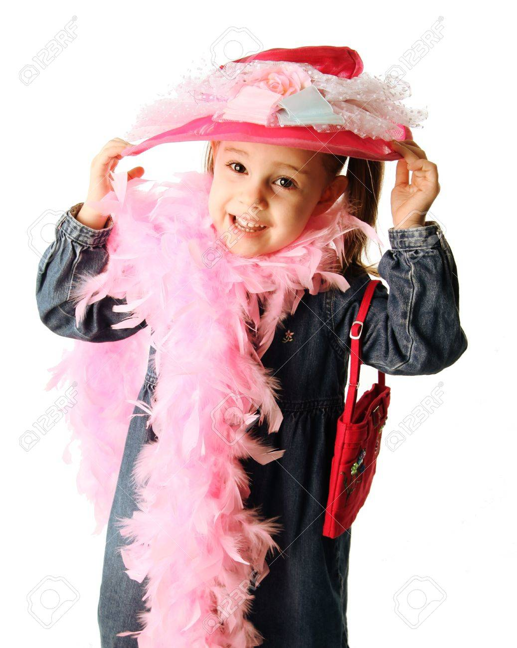 Portrait of an adorable preschool girl playing dress up with a fancy hat, purse, and pearl necklace isolated on white - 8809271