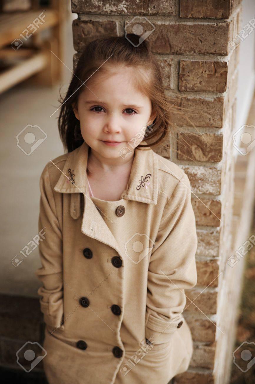 Beautiful young preschool girl outdoors wearing a peacoat blazer in the fall - 8809414