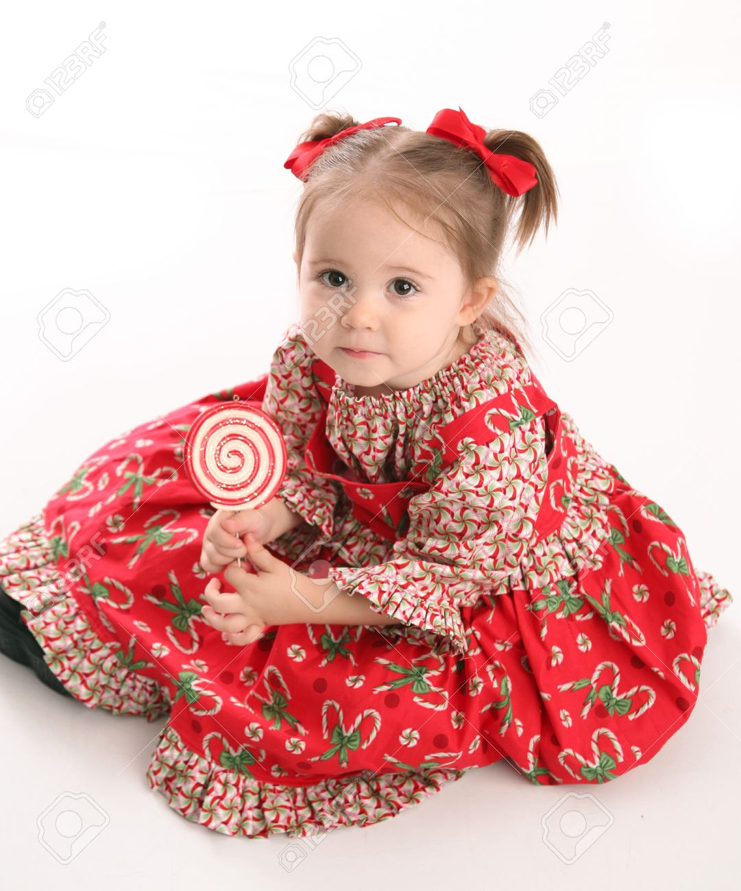 2167ed26d Adorable toddler girl wearing a Christmas holiday outfit posing, isolated  on white Stock Photo -