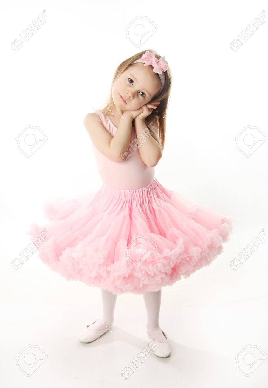 Portrait of an adorable preschool age girl playing dress up wearing a ballet tutu, isolated on white - 9939635
