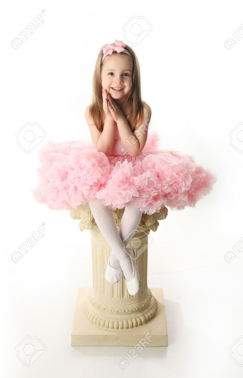 Portrait of an adorable preschool age girl playing dress up wearing a ballet tutu, isolated on white Stock Photo - 9939552