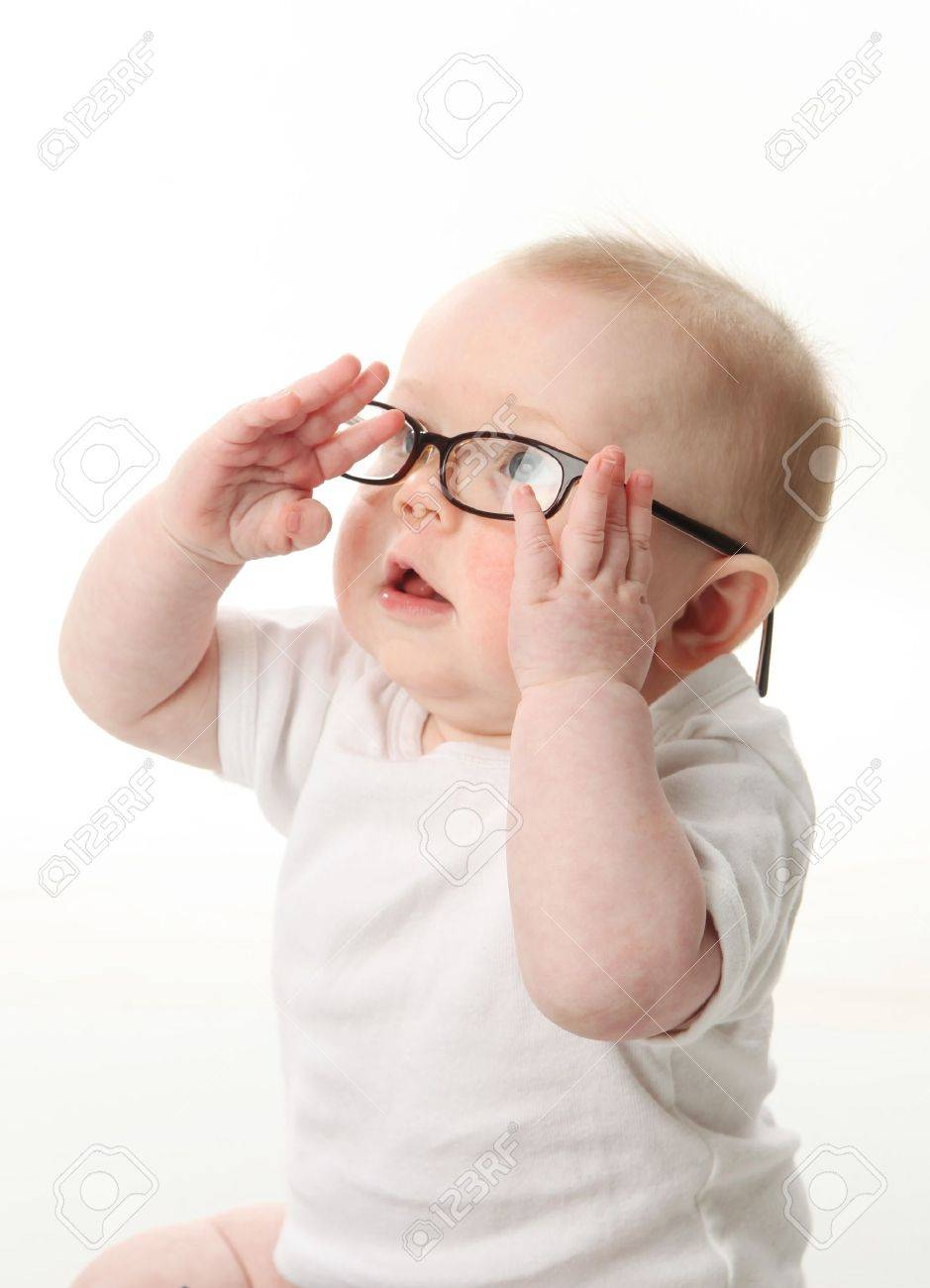 Portrait of a baby wearing eyeglasses and playing with them Stock Photo - 9939538