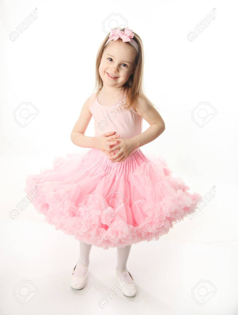 Portrait of an adorable preschool age girl playing dress up wearing a ballet tutu, isolated on white - 9939566