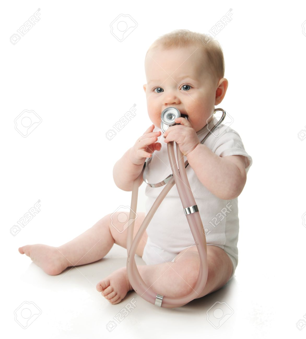 Portrait of a cute baby sitting playing with a stethoscope Stock Photo - 9939639