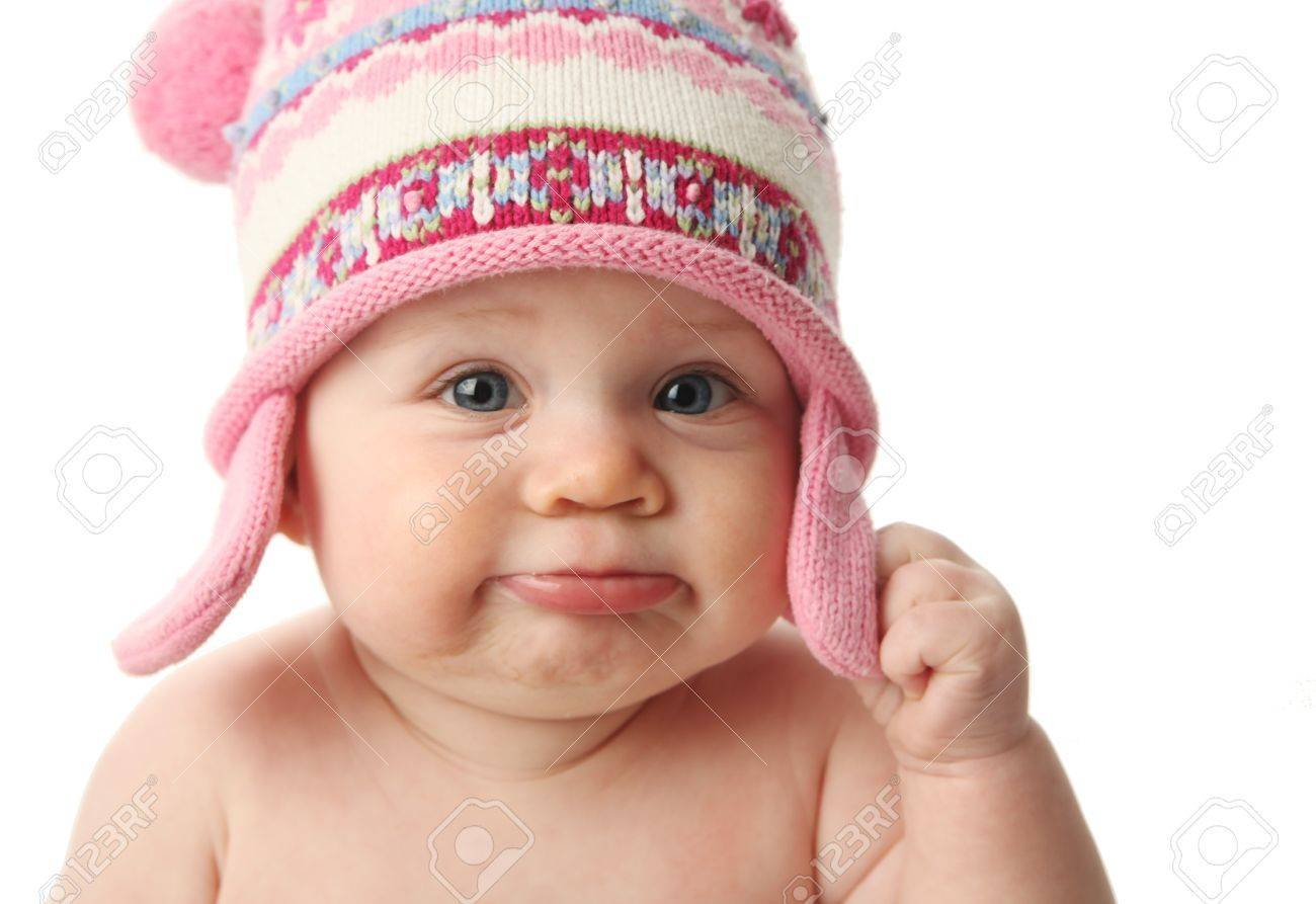 Close up portrait of an adorable baby wearing a knit winter cap, isolated on white - 9939558